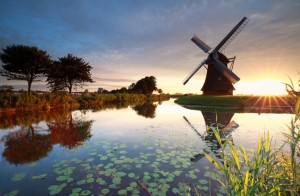 summer sunrise behind Dutch windmill, Holland