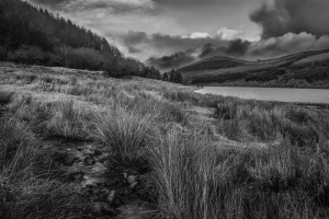 Moody image of a landscape overlooking the Talybont Reservoir, Brecon Beacons, Wales in the United Kingdom.