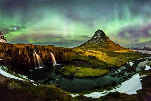 The Northern Lights dances over Mt. Kirkjufell in Iceland.