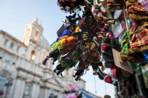 Christmas in Piazza Navona, in Rome. Vendors sells La Befana dolls throughout the season.